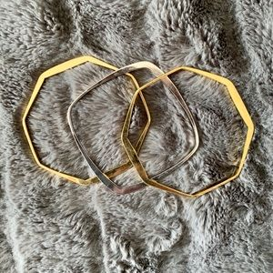 Mixed metal (silver and gold) geometric bangles